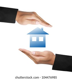 business hands protecting a house