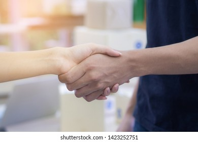 Business handshake after contract meeting in office. Woman and man shaking hands after meeting or negotiation for join partner business.  Success join partnership working with teamwork.