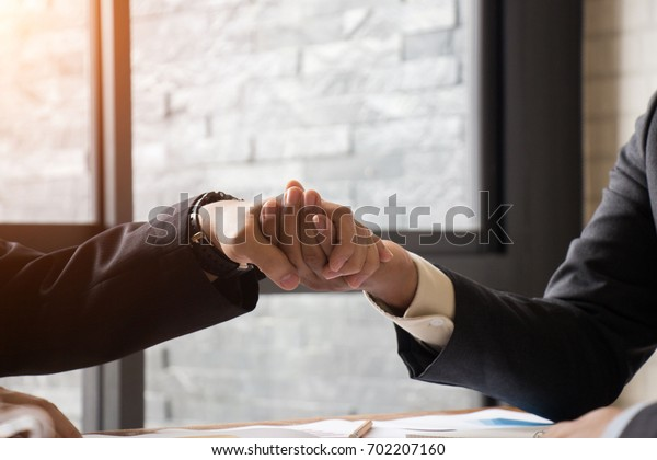 Business handshake Between manager to further invest in the future.