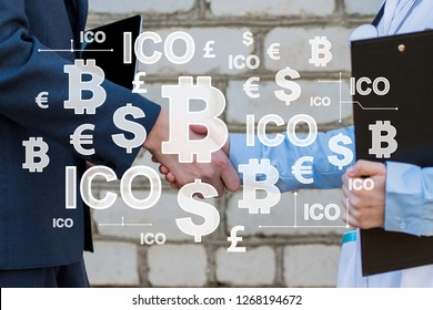 Business handshake. Businessman shaking hands with doctor cooperation. Business agreement by cryptocurrency ico Initial Coin Offering.