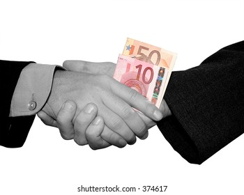 business handshake in b/w. with colored money