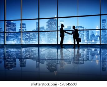 Business Handshake with City Skyline