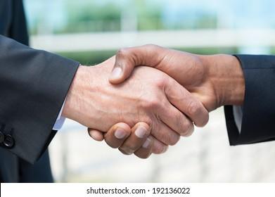 Business handshake. Close-up of business men shaking hands