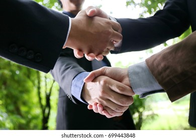 Business handshake for closing the deal after singing the lucrative contract between companies.Trust businessman partner concept.