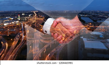 Business handshake with double exposure road background.