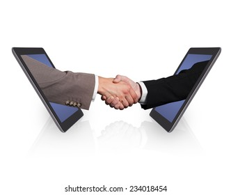Business handshake emerging from digital tablets isolated over white background