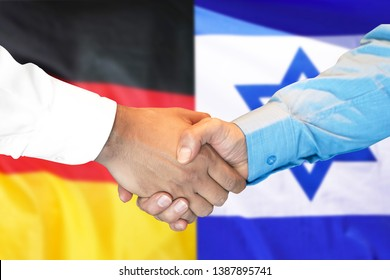 Business handshake on the background of two flags. Men handshake on the background of the Germany and Israel flag. Support concept