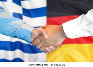 Business handshake on the background of two flags. Men handshake on the background of the Greece and Germany flag. Support concept