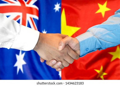 Business handshake on the background of two flags. Men handshake on the background of the Australia and China flag. Support concept