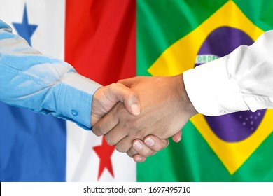 Business handshake on the background of two flags. Men handshake on the background of the Panama and Brazil flag. Support concept