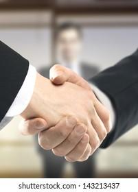 business handshake on people background