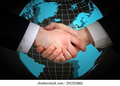 Business handshake on world map background