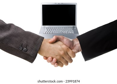 Business handshake over blurred laptop and white background