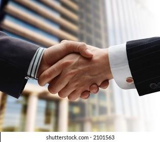 business handshake over blurry background