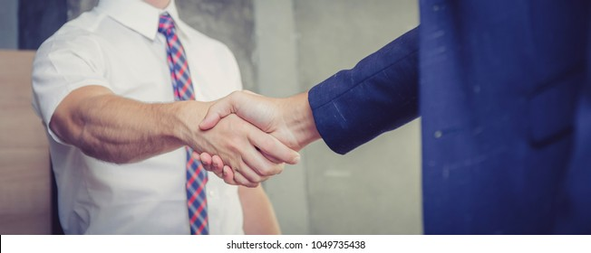 Business handshake with partner of success at the meeting room, businessman congratulation with teamwork, leader agreement of team concept, banner background.