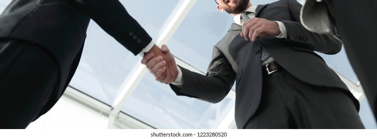 Business handshake and business people concept