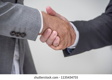 Business handshake and business people concept. Two men shaking hands at office  Partnership, Deal