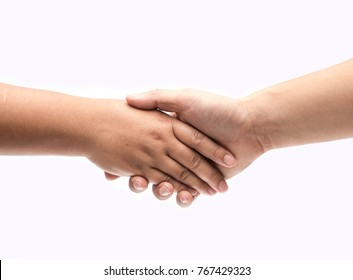Business handshake and business people concepts. Two people shaking hands isolated on white background. Close-up image of a firm handshake between two colleagues.
