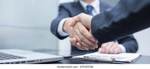 Business handshake and business people. panoramic banner - Shutterstock ID 679194760