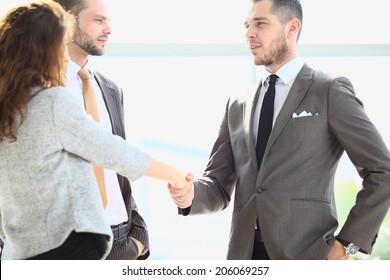 Business handshake. Business people shaking hands, finishing up meeting