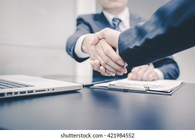 Business handshake and business people.  vintage tone.