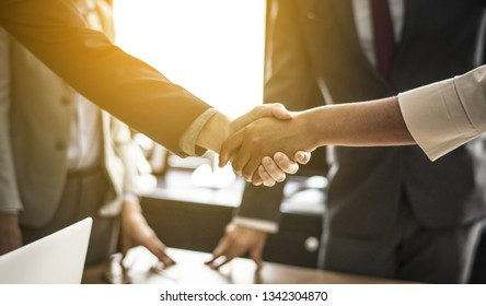 Business handshake symbolizing closing deal, couple signing contract, business people making agreement, successful job interview and hiring, taking bank loan, conclusion to effective negotiations.