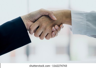 business handshake with two asian manager woman successful ideas concept
