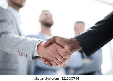 Business handshake. Two businessman shaking hands in office