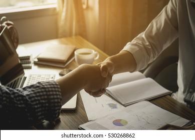 Business handshake of two men.