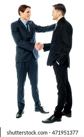 Business handshake of two successful partners over white.
