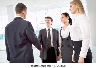 Business handshake of two successful partners at modern office