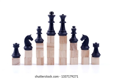Business hierarchy. Strategy concept. Pieces of chess with wooden blocks.