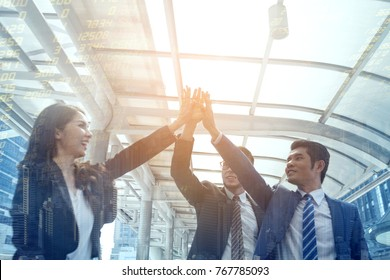 business high five showing Trustworthy team work.Managing small businesses with incentives to work as system incorporating a strong network. successful business people co-working .team partner concept