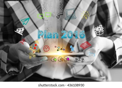 business holding a smart phone with PLAN 2016 text on black and white background ,business analysis and strategy as concept