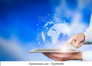 Business holding tablet touching screen world map.