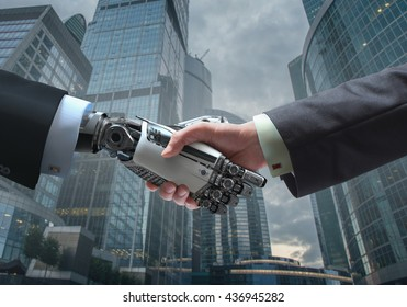 Business Human and Robot hands in handshake. Artificial intelligence technology Design Concept. Friendship between Artificial and real man conceptual template.