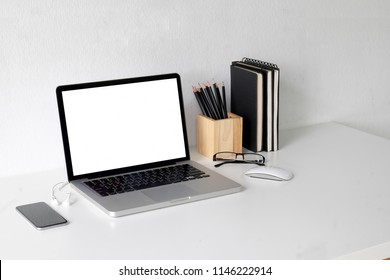 Business image, Blank screen laptop and supplies.