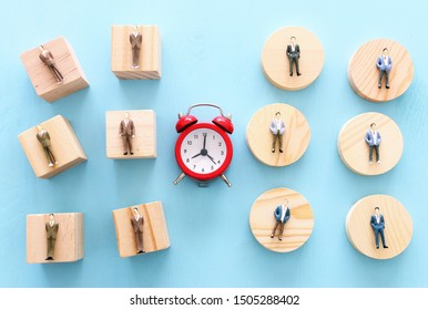 Business image of time management concept. Group of people and alarm clock, deadline and teamwork metaphor