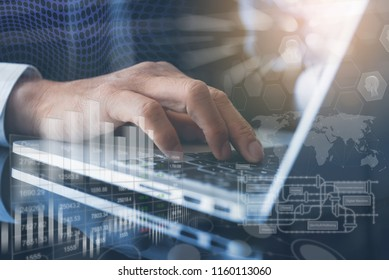Business intelligence BI, Internet of Things IoT concept. Business man working on laptop at modern office. Background of digital screen, worldwide connection icon, big data diagram, financial graph.