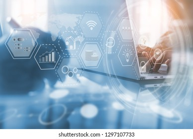 Business Intelligence BI, IoT Internet of Things Technology, Enterprise Resource Planning ERP concept. Businessman working on laptop computer in modern office with digital icons flow on virtual screen