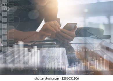 Business Intelligence, Business strategy analysis and stock market chart analyzing. Businessman working at modern office using smart phone with marketing report and  financial dashboard interface