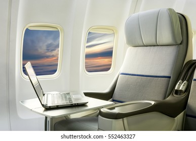 Business Interior Airplane with computer laptop