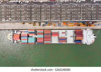Business International trade and Container logistics export-import harbor to the International port / Shipping Containers - Bird's-eye view from drone
