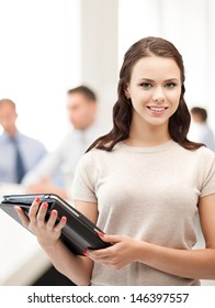 business, internet and technology concept - businesswoman with tablet pc in office