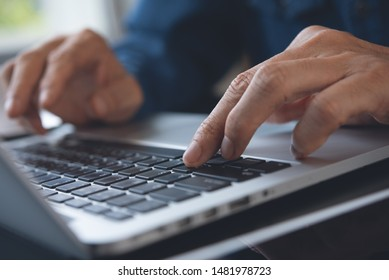 Business and internet technology, social network communication, online working concept. Close up of man hand working, typing on laptop computer keyboard, connecting internet in office