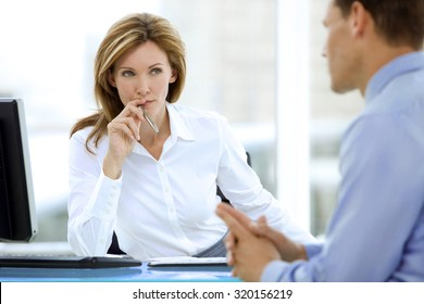 Business Interview. Female manager listening to a businessman at workplace.