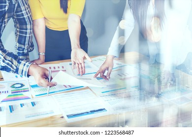 BUSINESS Investment Advisory Meeting PARTNER TEAM A์alyzes Company's Annual Financial Statements. Balance Sheets Work With Graph papers.REPORT AUDIT, TAX,Investment Analysis for Shareholders