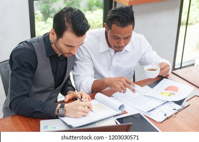 Business Investment Advisory Team Analyzes the company's annual financial statements. Balance sheets work with graph Papers.The concept of internal audit, tax audit, return on investment Analysis