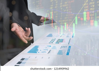 Business Investment Advisory Team Analyzes Company's Annual Financial Statements. Balance Sheets Work with Graph Papers. Concept of internal audit , Tax Return on Investment analysis Shareholders