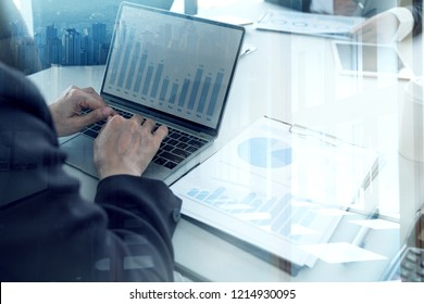 Business Investment Advisory Team Analyzes Company's Annual Financial Statements. Balance Sheets work with Graph papers.Concept of Internal Audit Tax Return on Investment Analysis Shareholders